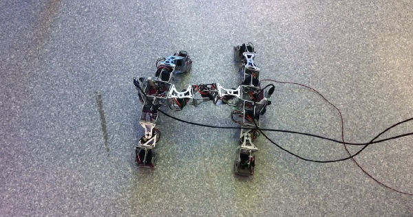 Modular H-shaped four-legged robot