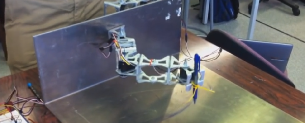 Servo motor used as input device to control a robotic arm