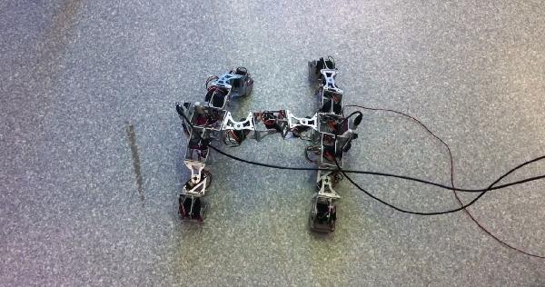 Modular H-shaped four-legged robot